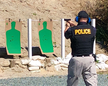 Police Officer Practicing on a Firing Range
