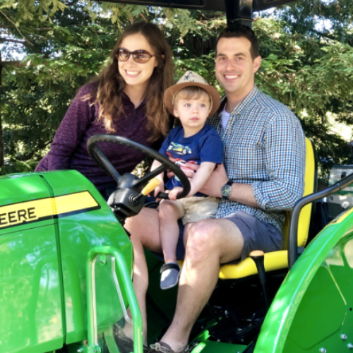 Family sits together on a tractor at Moraga's annual Pear Festival