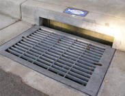 Storm Drain Covered by a Metal Grate